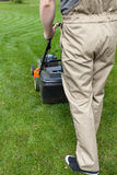 Man mowing home garden lawn Royalty Free Stock Photography