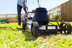 Man mowing house garden Stock Photography
