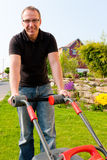 Man mowing lawn Royalty Free Stock Image