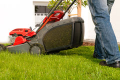 Man mowing lawn Royalty Free Stock Photos