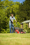 Man mowing lawn Stock Photos