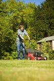 Man mowing lawn Stock Photos