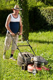 Man mowing the lawn Stock Photos