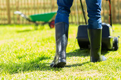 Man mowing lawn Stock Images