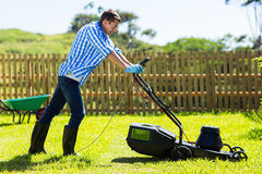 Man mowing lawn backyard Royalty Free Stock Images