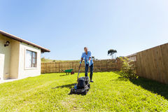 Man mowing lawn Stock Image