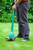 Man mowing lawn with grass trimmer Stock Photography