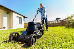 Man mowing lawn at home Stock Photos