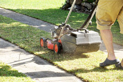 Man mowing lawn with lawn mower in the garden Royalty Free Stock Photo