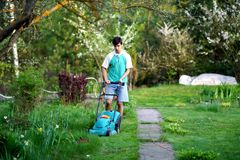 Man mowing the lawn with lawnmower Royalty Free Stock Photography