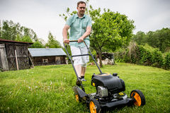 Man mowing lawn Royalty Free Stock Images