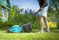 Man mowing the lawn in the yard Royalty Free Stock Photography