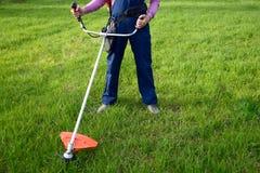 Man mows a grass Stock Image