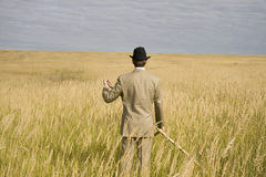 A man mows a grass with a scythe Royalty Free Stock Image