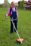 Man mows a grass Stock Images