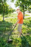 Man mows a lawn mower Royalty Free Stock Image