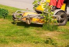 Man mows a lawn mower. Outside closeup royalty free stock photo