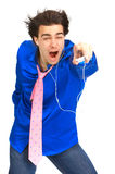 Man with mp3-player. Happy young man with mp3-player. Over white background Royalty Free Stock Image