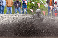 Man in mud on 4 wheeler Stock Photo
