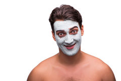 The man with mud mask isolated on white Stock Image