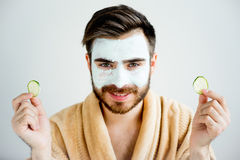 Man with a mud mask stock images