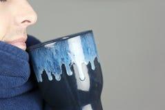 Man With Mug Bundled In Robe Royalty Free Stock Photos