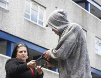 Man Mugging Woman In Street Stock Image