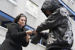 Man Mugging Woman In Street Stock Photos
