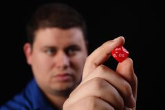 Man with Multi Sided Dice Right. A man with a multi-sided dice Royalty Free Stock Photography