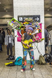 Man with multiple music instruments performing at Metro station Royalty Free Stock Photo