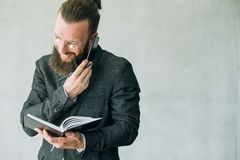 Man multitask talk phone write business lifestyle. Man multitasking talking on the phone and writing in notepad. successful business man lifestyle royalty free stock photos