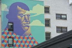 Man Mural and building windows in Portland, Oregon. This is the mural of a man with building windows in downtown Portland, Oregon Stock Photos