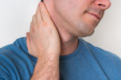 Man with muscle injury having pain in his neck Royalty Free Stock Image