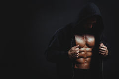 Man with muscular torso. Bodybuilder man with muscular torso isolated on black royalty free stock images