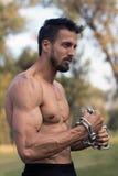 Man with muscular torso. Muscular Man Fitness Model Torso showing. Beard Man royalty free stock photo