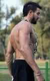 Man with muscular torso. Muscular Man Fitness Model Torso showing. Beard Man stock photo