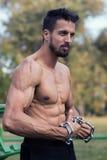 Man with muscular torso. Muscular Man Fitness Model Torso showing. Beard Man stock photos