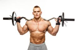 Man with muscular torso posing Stock Photography