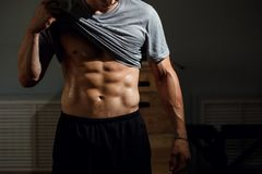 Strong Athletic Man Fitness Model Torso showing six pack abs. Man with muscular torso showing six pack abs royalty free stock photography