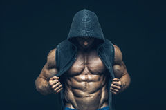 Man with muscular torso. Strong Athletic Men. Man with muscular torso. Strong Athletic Man Fitness Model Torso showing six pack abs royalty free stock photography