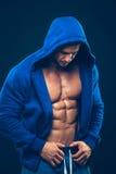 Man with muscular torso. Strong Athletic Men Stock Photos