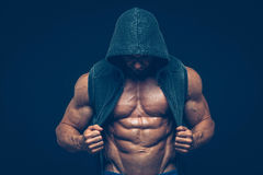 Man with muscular torso. Strong Athletic Men Stock Photo
