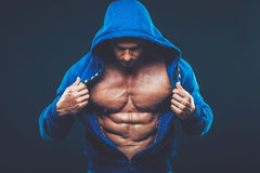 Man with muscular torso. Strong Athletic Men Fitness Model Royalty Free Stock Images