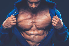 Man with muscular torso. Strong Athletic Men Fitness Model Stock Images