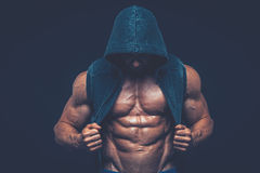 Man with muscular torso. Strong Athletic Men Fitness Model Royalty Free Stock Photography