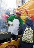 A man in a mushroom suit pours mushroom soup at a folk festival Stock Images