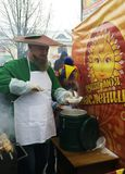 A man in a mushroom suit pours mushroom soup at a folk festival Stock Photography