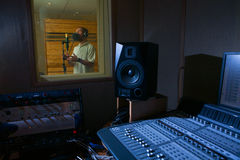 Man in the music studio. A man who is singing in the music studio royalty free stock photo