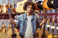 Man in musical shop Royalty Free Stock Images