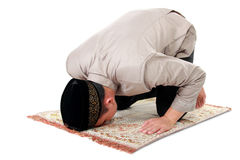 Man muslim doing prayer. Isolated over white background royalty free stock image